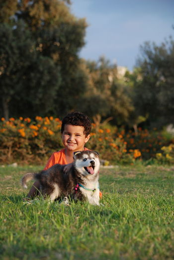 Animal Themes Day Dog Domestic Animals Friendship Grass Growth Kid Looking At Camera Nature One Animal One Person Outdoors People Pets Portrait Real People Sky Smiling Tree Young Adult Dogs Of EyeEm Dogsofinstagram Dogoftheday