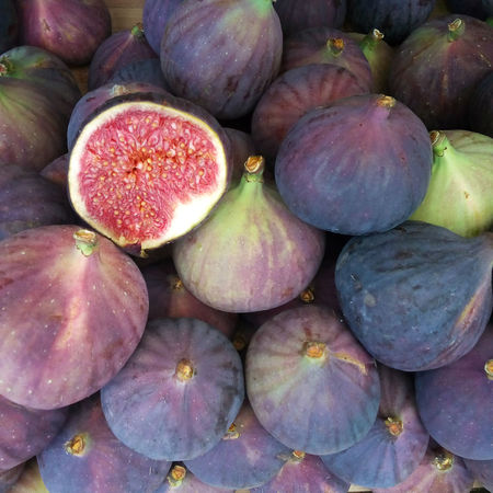 Closeup shot fresh ripe figs. Lots of organic figs at the market. Figs background. Autumn Diet Exotic Market Raw Rustic Backgrounds Close-up Fig Figs Fresh Freshness Fruit Healthy Healthy Eating Ingredient Juicy Nutrition Purple Raw Food Ripe Sweet Tasty Tropical Vegeterian