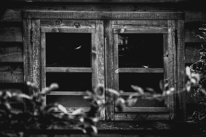 The wood cabin was as i remembered......but the there was no light.....no life.....only darkness. Abandoned Architecture Blackandwhite Photography Cabin Cabin In The Woods Close-up Closed Day No People Outdoors Window Windows Windows And Doors Windows_aroundtheworld Wooden Wooden House Wooden House Window Wooden Structure