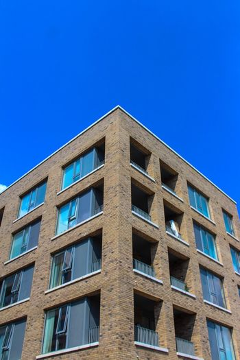 London Architecture Blue Built Structure Sky Architecture Low Angle View Building Exterior Clear Sky Building Window No People Day Copy Space Outdoors City Repetition Glass - Material Sunlight Residential District Office