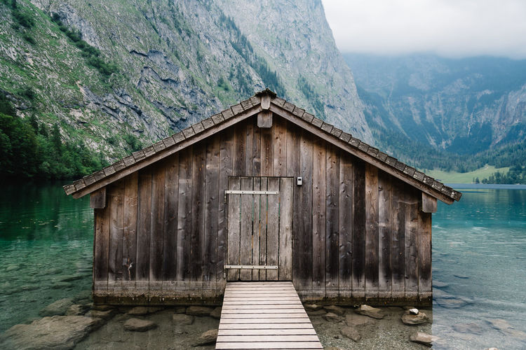 Beautiful wooden cottage in alpine lake Nature Obersee View Adventure Alps Architecture Bavarian Alps Beauty In Nature Built Structure Cottage Day Hut Lake Lake View Landscape Mountain Mountain Range Nature No People Outdoors Scenery Scenics Sky Tranquil Scene Tranquility Water Wood - Material