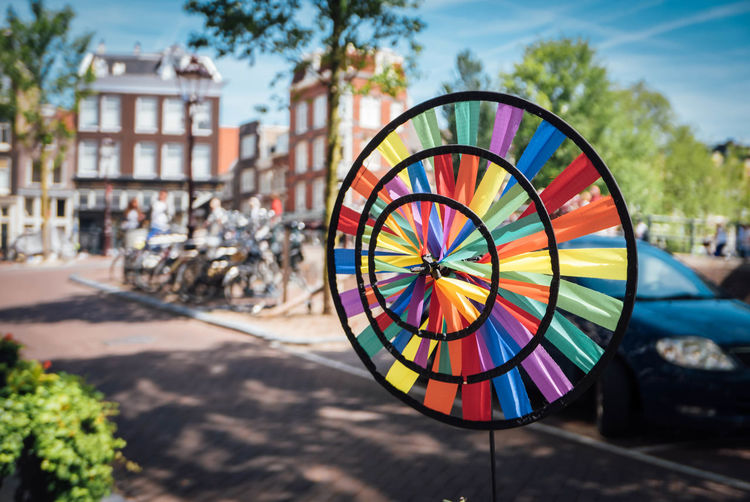 Close-up of colorful pinwheel toy by street