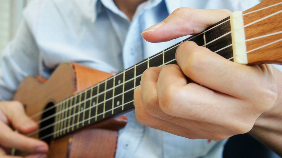 Man playing classical ukulele Classic Close-up Day Fingers Folk Fretboard Guitar Hobbies Human Hand Indoors  Joy Melody Music Musical Instrument One Person Performance Playing Relaxing Song Strings Ukulele Wood