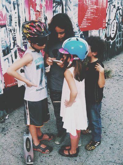 Gather around the mobile device. EyeEm Adventure Brooklyn Children Williamsburg, Brooklyn  Streetphotography