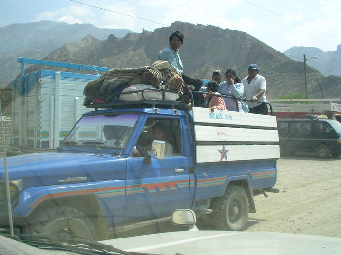 people riding on a pick up truck Local City On A Hill Cultures Day Food Microfinance People