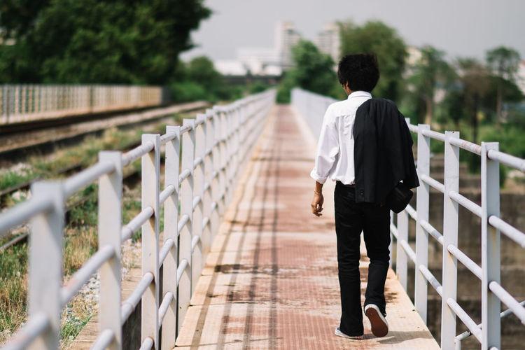 Businessman walking on footbridge