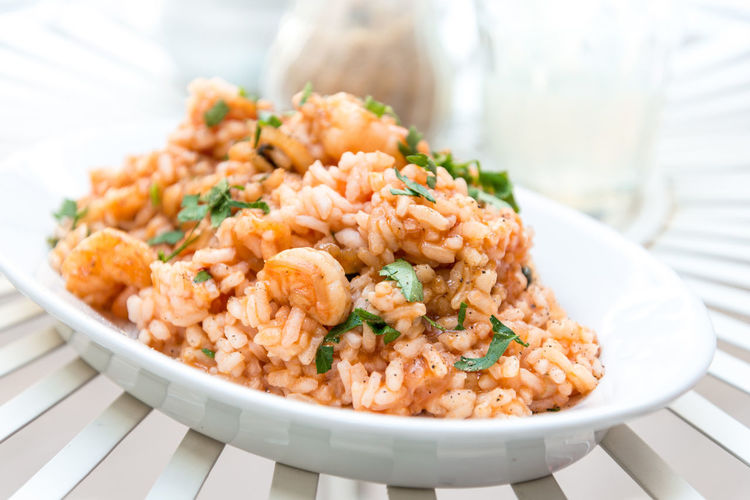 Close-up of prawns rice in plate on table