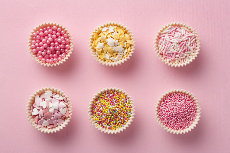 Flat lay of colorful sprinkles on a pink background. Top view of cake decoration Cake Candy Colorful Decoration Dessert Flat Lay Heart No People Pile Pink Pink Color Sprinkle Sprinkles Star Sweet Sweet Food Top View Topping