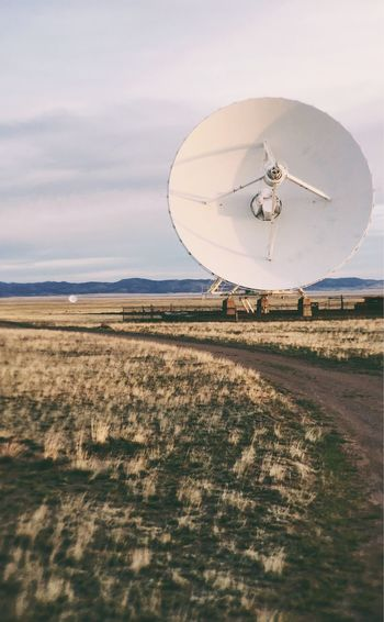 View Of Dish Antenna On Countryside Landscape