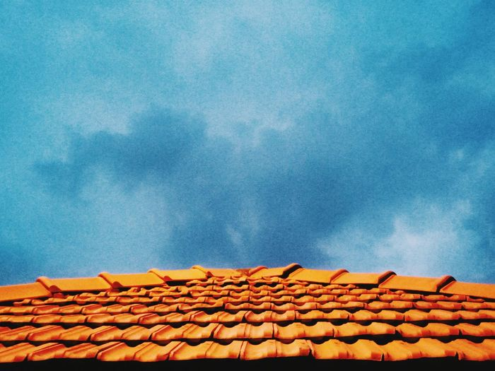 Low angle view of houses against sky