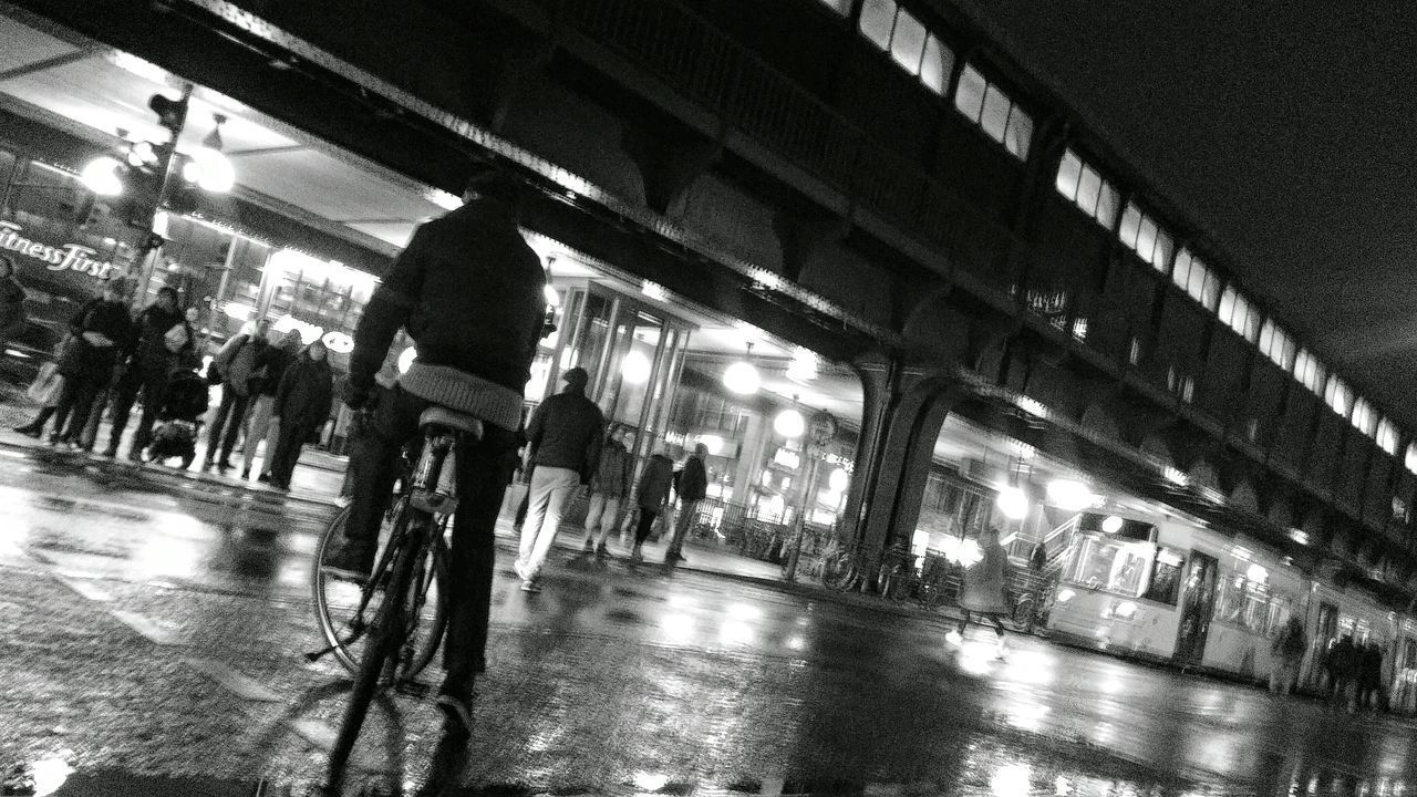 bicycle, transportation, cycling, illuminated, night, land vehicle, mode of transport, bridge - man made structure, speed, city life, architecture, city, road, built structure, lifestyles, commuter, men, outdoors, real people, one person, adult, people, adults only