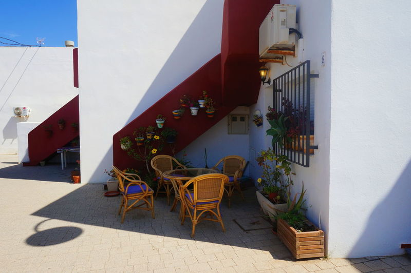 Las Negras Red White Lasnegras Light Almería Andalusia Almería SPAIN Colors Beach Shadow Chair Water Table Architecture Sky Built Structure Awning Hooded Beach Chair Closed Door Knocker Residential Structure Door Closed Door Outdoor Chair Ocean Calm Beach Umbrella