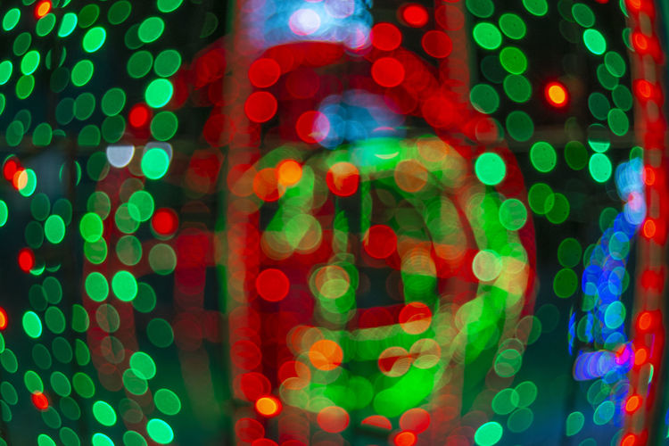 Illuminated Night Lighting Equipment Pattern Multi Colored No People Defocused Light Shape Abstract Decoration Celebration Circle Geometric Shape Electric Light Red Motion Backgrounds Lens Flare Electricity  Nightlife Black Background Glowing Bokeh Christmas Lights
