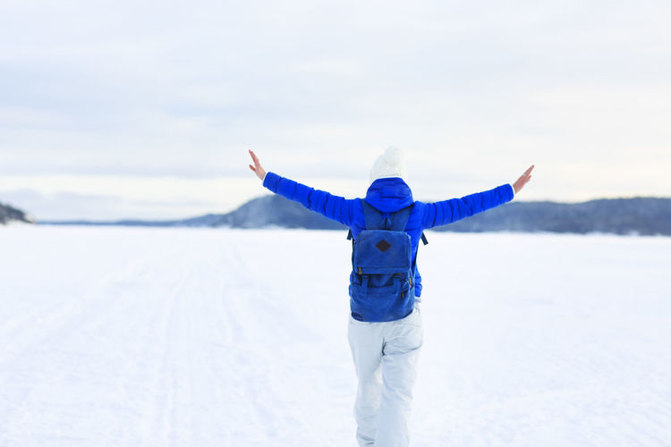 Man with arms outstretched on snow