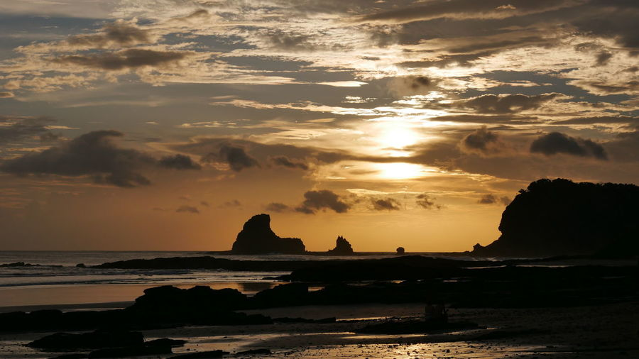 Sky Sea Sunset Water Scenics - Nature Beauty In Nature Rock Cloud - Sky Beach Land Rock - Object Tranquility Tranquil Scene Orange Color Solid Nature Horizon Horizon Over Water Idyllic No People Outdoors Stack Rock Nicaragua