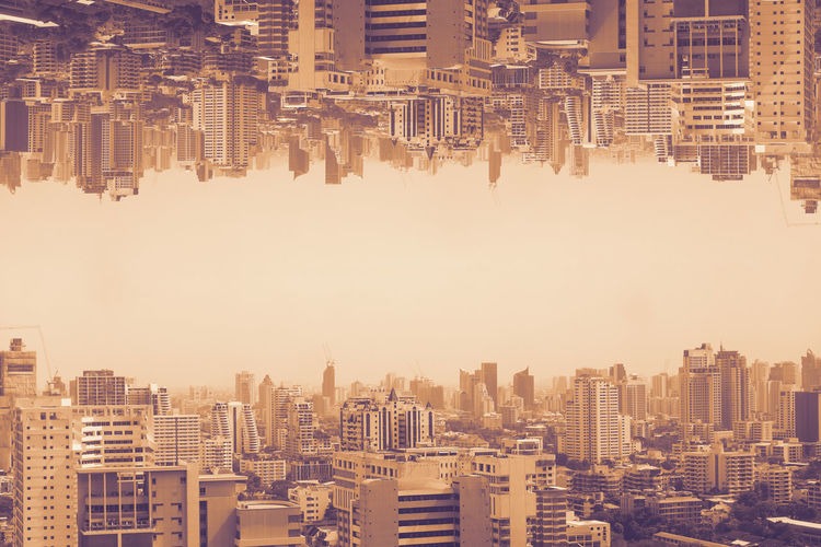 Double exposure photography of aerial cityscape in poor weather morning, haze of pollution