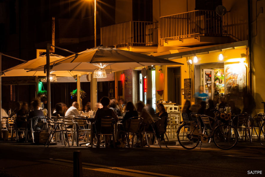 Architecture Built Structure By The Sea City City Life Illuminated Italian Night Lifestyles Marina Medium Group Of People Night Outdoors People Together By August 3 2016 Restaurant Summertime