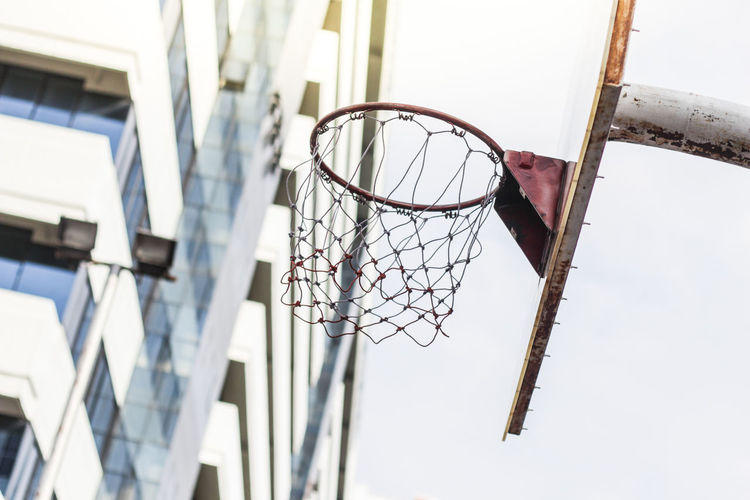Architecture Art And Craft Basketball - Sport Basketball Hoop Building Building Exterior Built Structure Close-up Craft Day Focus On Foreground Hanging Low Angle View Metal Nature Net - Sports Equipment No People Outdoors Sky Sport