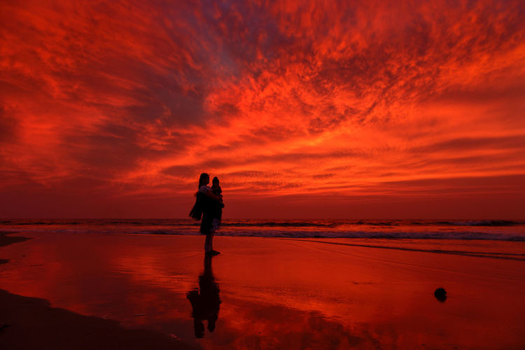 Mother and Child on Beach Beach Beauty In Nature Cloud Cloud - Sky Cloudy Coastline Dramatic Sky Full Length Horizon Over Water Leisure Activity Lifestyles Mother And Child Nature Orange Color Outdoors People And Places Scenics Sea Shore Sky Sunset Tranquil Scene Tranquility Vacations Water
