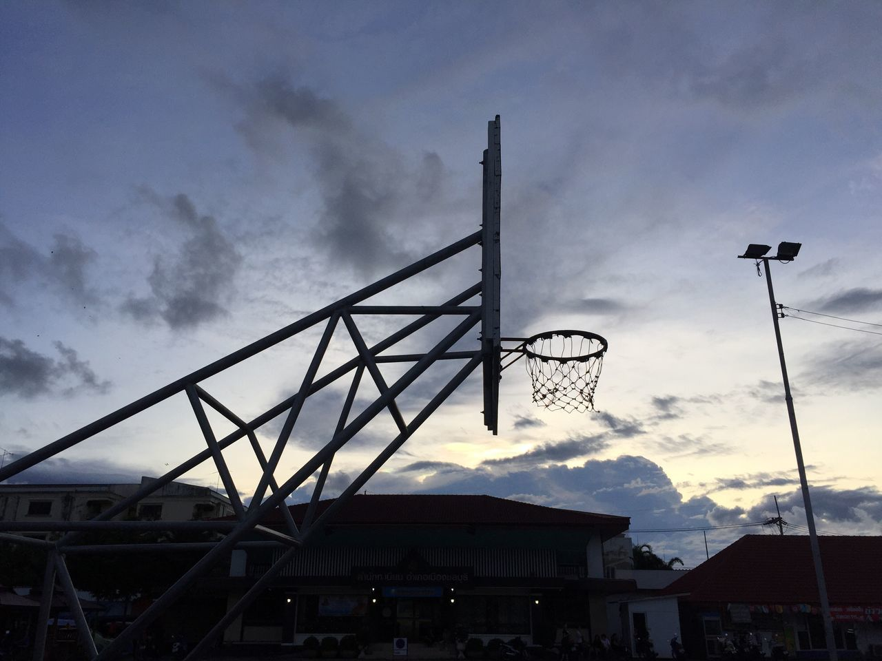 cloud - sky, sky, low angle view, built structure, architecture, outdoors, silhouette, no people, day, building exterior, basketball hoop, basketball - sport