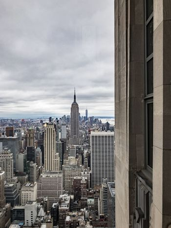 Architecture Building Exterior Built Structure City Cityscape Cloud - Sky Day Downtown District Empire State Bldg. Empire State Building Modern No People Office Building Exterior Outdoors Rainbow Colors Rainbow Room Sky Skyscraper Tower Travel Destinations Urban Skyline