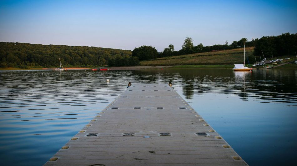 Sitting on a jetty waiting for the golden hour... Lake Bestseatsinthehouse Beauty Photography Quiet Moments Solitude Nature Photography Twilight Feelslikesummer Taking Photos