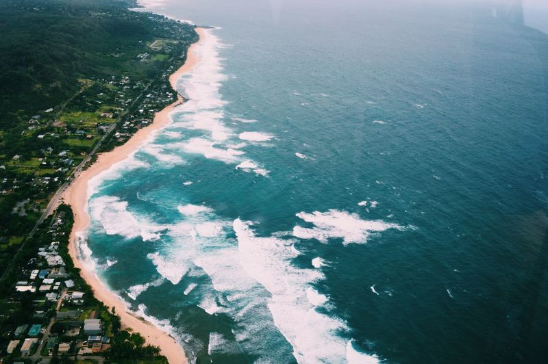 High Angle View Of Sea By Landscape