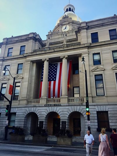 City hall in July Flag Patriotism Building Exterior Architecture Government Built Structure Politics Politics And Government Women Clear Sky Men Democracy Real People Day Outdoors City Adult Sky People Summer America