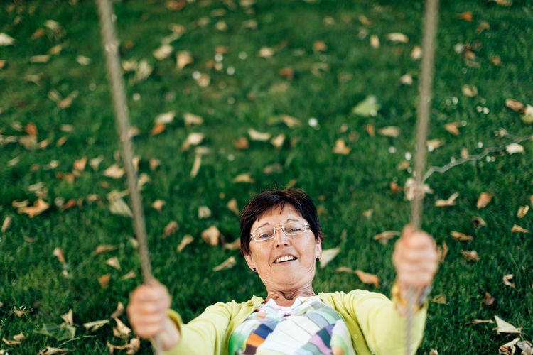 Top view of a healthy old lady on the swing - active and playful third age