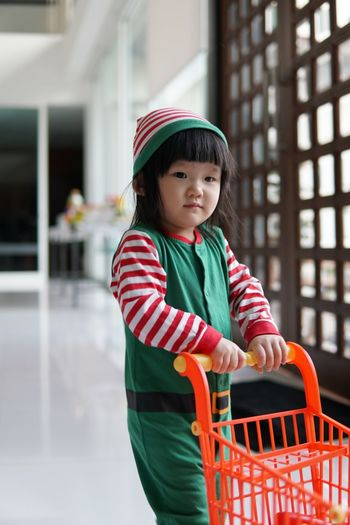 Little Elf Toys Baby Elf Christmas Lifestyles One Person Cute Shopping Cart Real People Smiling Child Supermarket Happiness Portrait