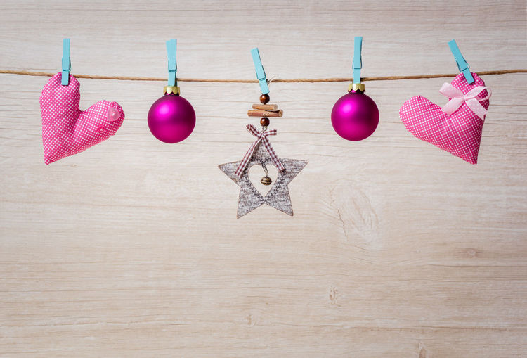 Close-up of christmas decoration hanging on table