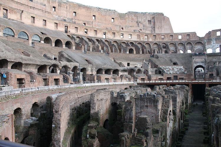 Historic colosseum against sky