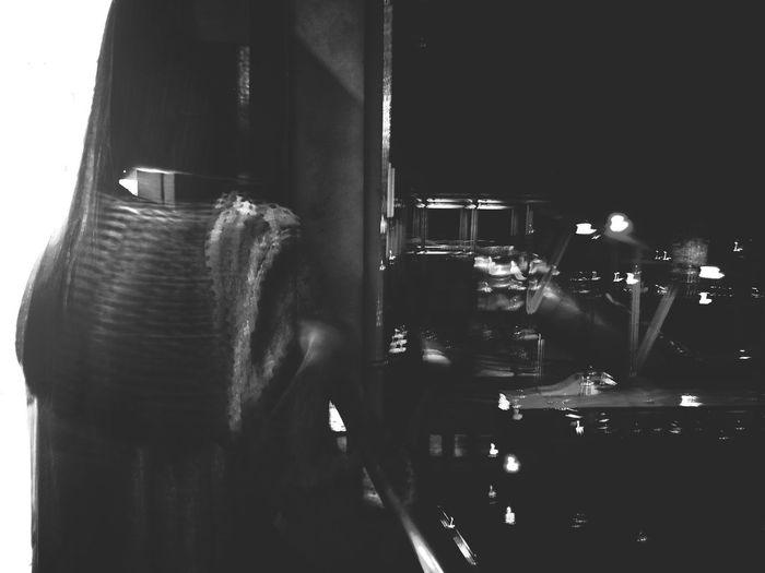 Rear view of man using smart phone at night