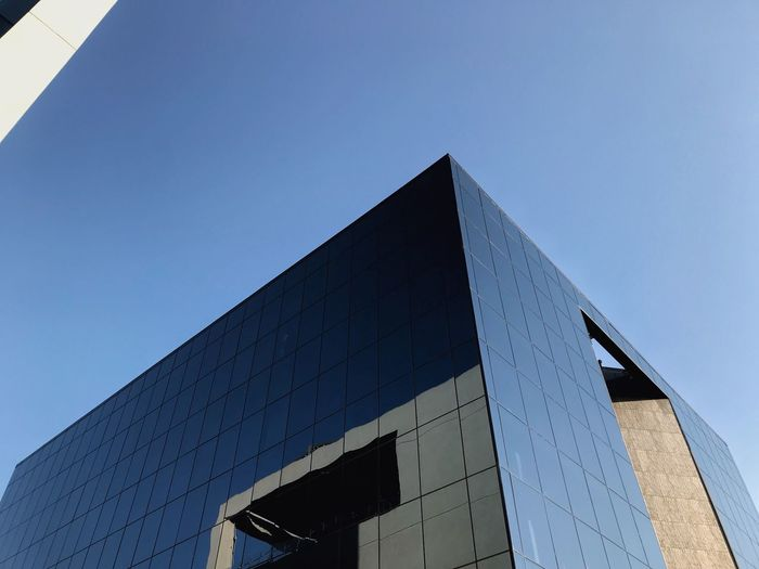 Blue building Glass Building Sky Achitecture Office Building Exterior Reflection Outdoors City Modern Glass - Material Office Sunlight No People Nature Copy Space Day Blue