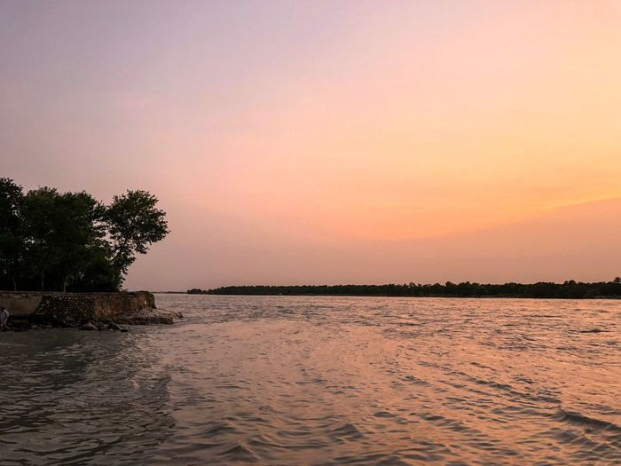 Sunset at Indus River, KPK Pakistan Pakistan KPK River Indus River Sky Sunset Water Scenics - Nature Beauty In Nature Tree Tranquil Scene Tranquility Plant Waterfront Orange Color Nature Copy Space Silhouette Idyllic No People Outdoors Sea Lagoon