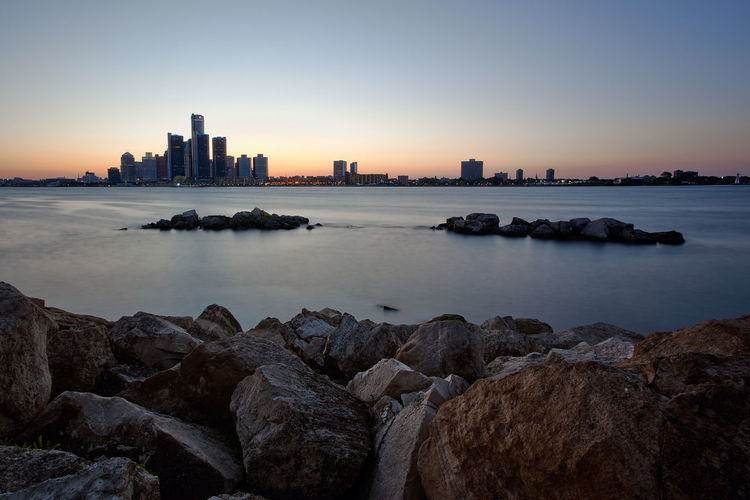Sunset Landscape View of Detroit, Michigan from Windsor, Ontario Detroit Detroit City Detroit Cityscape Detroit River EyeEmNewHere Postcard Rocky USA United States View Background Blue Landscape Rennaisance Rennaisance Center Rock Rock - Object Rocks Scene Scenery Scenics - Nature Sky Sunset Urban Skyline Water