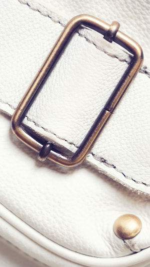 Detail part of vintage leather bag with selective focus for background Luxury Personal Accessory Beauty Simplicity Textile White Background White Color Close-up Still Life Single Object Details Textures And Shapes Vintage Style And Fashion Bag Part Of Leather Bag Textured  Backgrounds Locked Design Indoors  No People