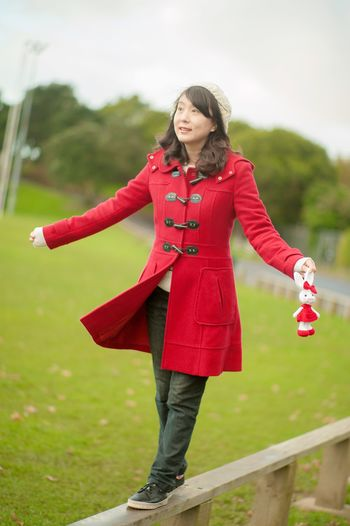 Full Length One Person Casual Clothing Outdoors Red Day Smiling Front View Leisure Activity Happiness Real People Lifestyles Young Women Standing Portrait Beautiful Woman Young Adult Grass Nature