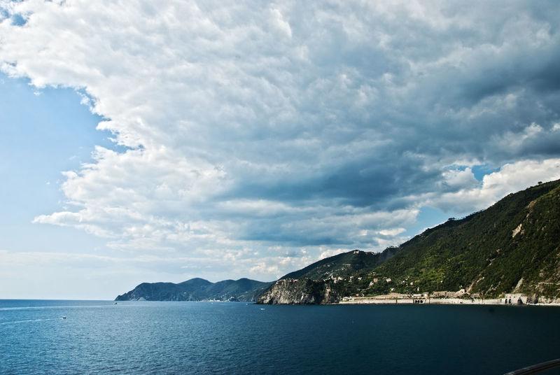 Atmospheric Mood Beauty In Nature Calm Cinque Terre Cloud - Sky Cloudscape Coastline Dramatic Sky Italian Riviera Italy Majestic Mountain Range Nature Non-urban Scene Ocean Outdoors Remote Scenics Sea Sky Tranquility Waterfront