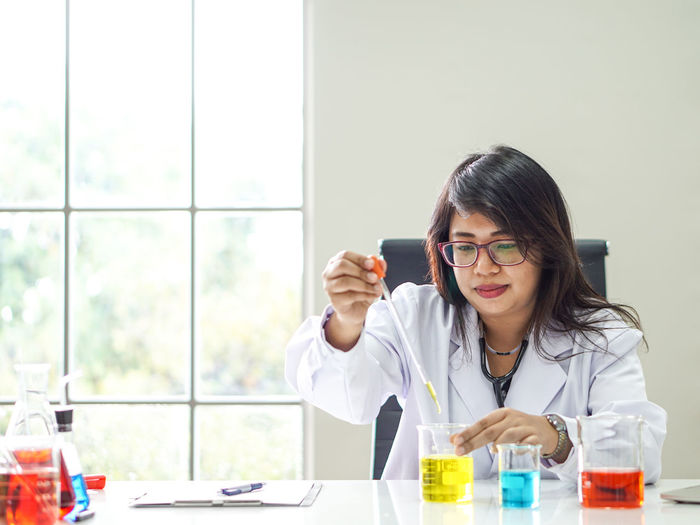 Doctor Analyzing Chemicals In Laboratory