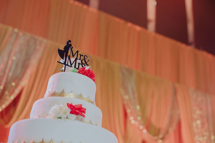 Low angle view of text on birthday cake