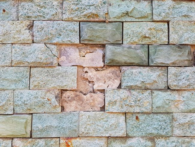Close up of bricks. Brick Wall Backgrounds Full Frame Textured  Pattern Stone Tile Close-up Rough Rugged Seamless Pattern