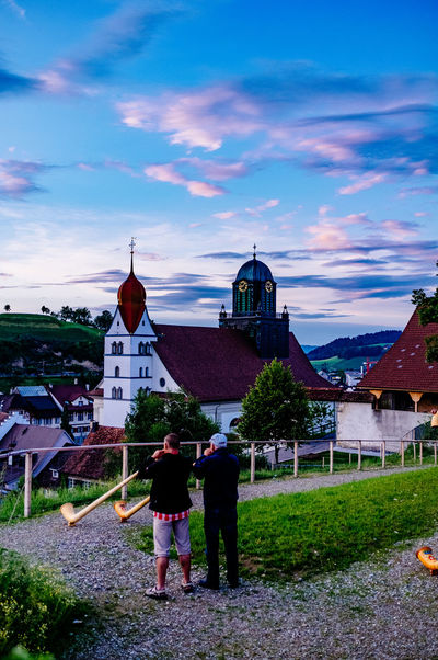 Alphorn Architecture Built Structure Casual Clothing City Life Cloud Cloud - Sky Cloudy Day Grass Leisure Activity Lifestyles Nature Outdoors Sky