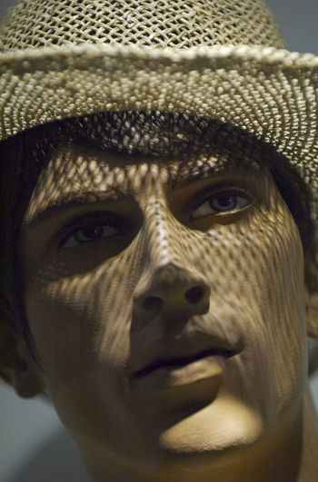 Close-Up Of Male Mannequin With Sun Hat