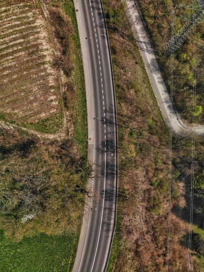 Top down view of the road between the fields Geneve Aerial Switzerland Swiss Drone Photograph DJI Mavic Air DJI X Eyeem No People High Angle View Day Transportation Nature Road Sunlight Grass Outdoors Water Aerial View Field Landscape Pattern Land Plant Wet Growth Agriculture Wheel My Best Photo