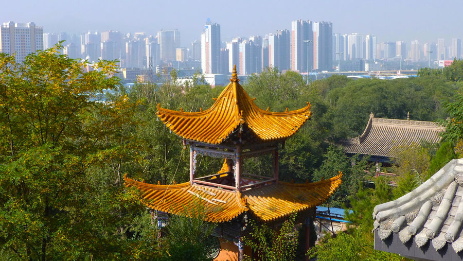 Mix of tradition and modernity, in the view of Xining from the top of the Taoist Temple EyeEmNewHere Qinghai Skyline TaoistTemple Pagoda Temple Skyscraper View Taoist Temple Xining