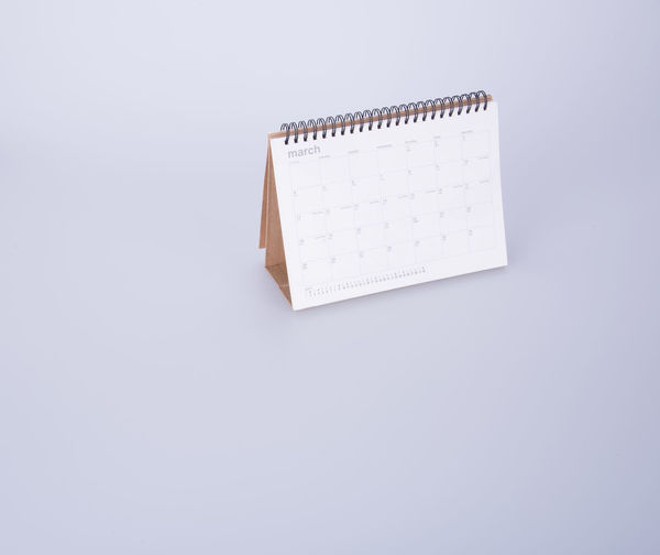 High angle view of desk calendar on white background