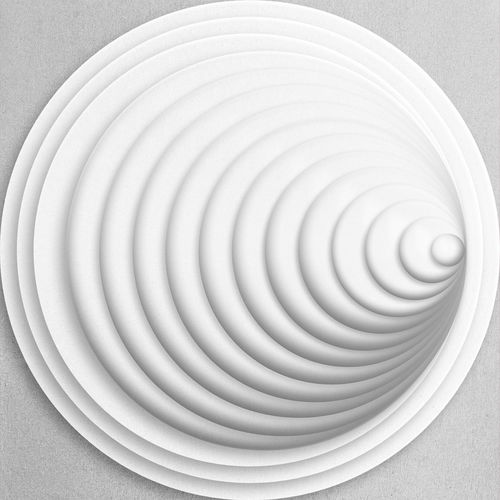 Directly above shot of spiral on white table against wall