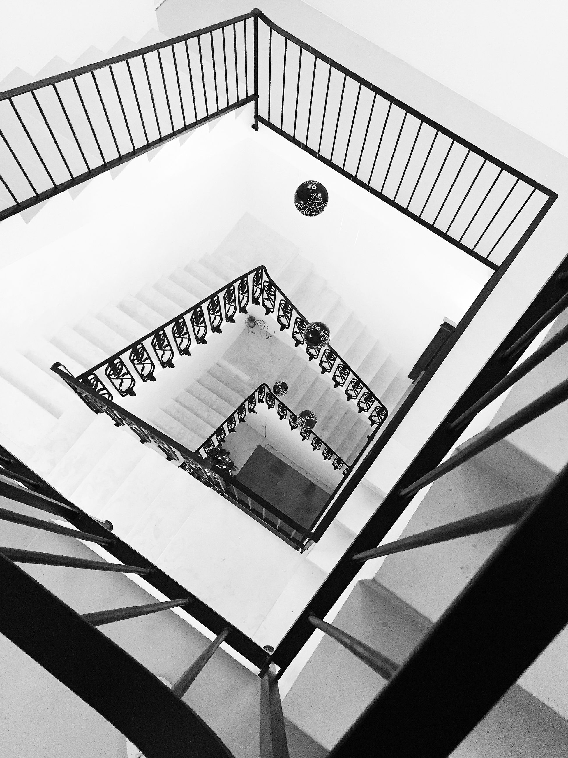 built structure, architecture, low angle view, railing, indoors, staircase, modern, steps, steps and staircases, connection, clear sky, day, no people, building, building exterior, metal, pattern, text, design, sky