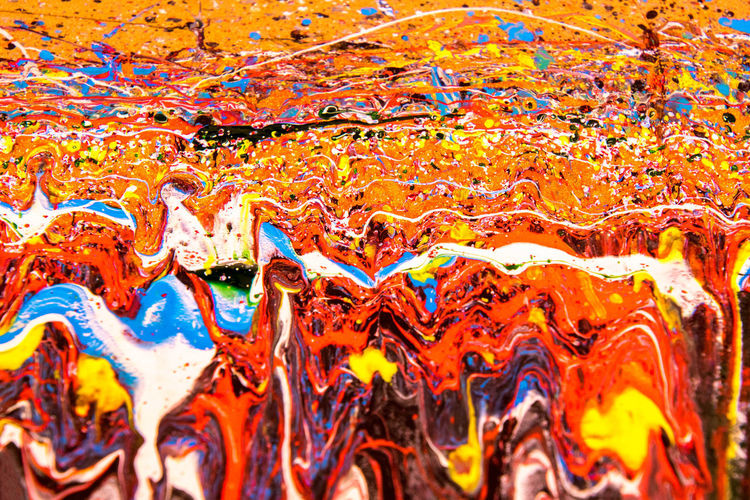 Full frame shot of multi colored painting on water
